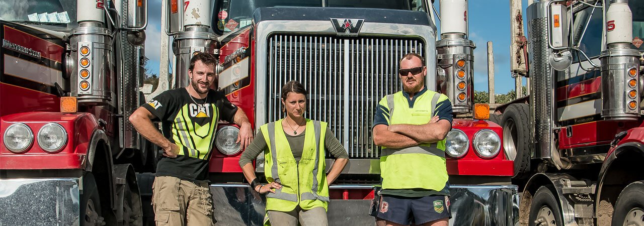 Holmes Group staff with trucks